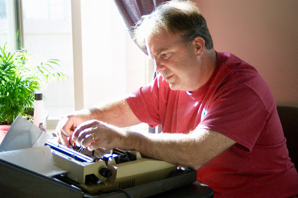 Rob repairing a typewriter. Jot and Tittle vintage typewriters