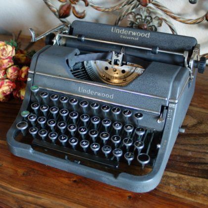 vintage typewriter and rose bouquet