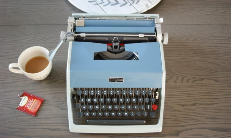 1957 olivetti vintage typewriter in two-tone blue