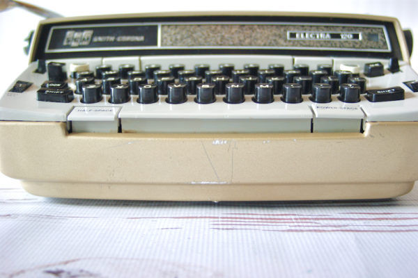 close up gold metallic typewriter
